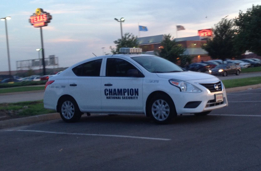 Champion Security Car Parked in Parking Lot